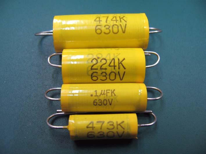 マイラコンデンサです。色は黄色が基本ですが、黄色以外にもありますよ。銀とか、緑とか。